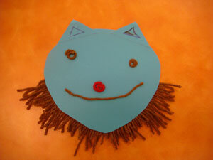 Shown is a mask with a cheerful expression.