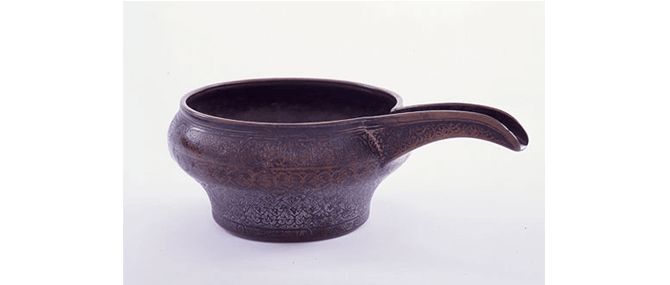 <p><b><i>Spouted Bowl</i></b>, Iran, late Timurid, late 15th century. Bronze. Overall: 4 1/4&#8221; x 11 1/4&#8221;. Gift of Drs. Joseph B. and Omayma Touma, 1991.2.2.</p>