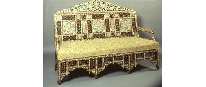 <p><b><i>Sofa</i></b>, Damascus, Syria, 19th century, mid-19th century. Ebony, mother of pearl, silver, bone. Overall: 51 1/2 x 68 x 31&#8221;. Gift of Drs. Joseph B. and Omayma Touma, 1991.2.55.</p>